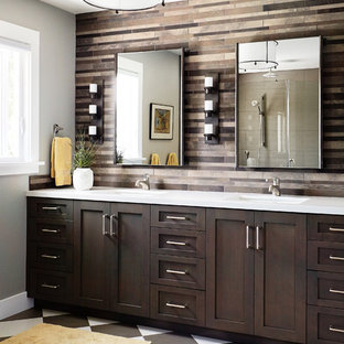 Mid-sized transitional master brown tile and stone tile porcelain floor and multicolored floor bathroom photo in San Francisco with an undermount sink, shaker cabinets, dark wood cabinets, gray walls and solid surface countertops
