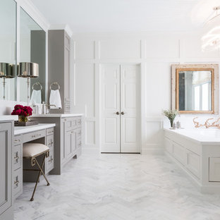 Inspiration for a transitional master white floor bathroom remodel in Houston with recessed-panel cabinets, gray cabinets, an undermount tub and white walls