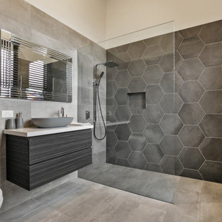 Design ideas for a contemporary 3/4 bathroom in Other with gray tile, grey walls, grey floor, beige benchtops, a niche, a single vanity, a floating vanity, flat-panel cabinets, black cabinets, a curbless shower, a vessel sink and an open shower.