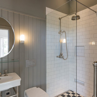 This is an example of a small classic shower room bathroom in Other with a wall mounted toilet, white tiles, metro tiles, a console sink, multi-coloured floors, an open shower, a corner shower and grey walls.