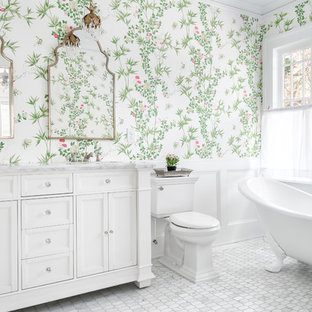 Design ideas for a traditional master bathroom in Atlanta with recessed-panel cabinets, white cabinets, a claw-foot tub, a two-piece toilet, multi-coloured walls, marble floors, marble benchtops, grey floor and grey benchtops.