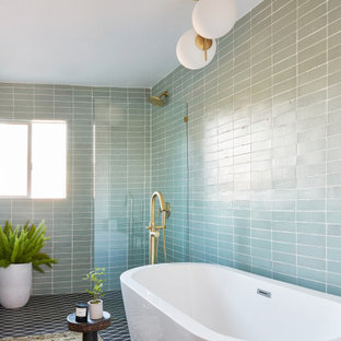 Large 1950s master green tile and ceramic tile double-sink, ceramic floor, black floor and brick wall bathroom photo in Los Angeles with light wood cabinets, gray countertops and green walls
