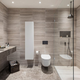 Inspiration for a medium sized contemporary bathroom in London with a wall mounted toilet, beige tiles, grey walls and a wall-mounted sink.