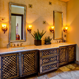 Inspiration for a small mediterranean bathroom in Phoenix with a submerged sink, beige tiles, medium wood cabinets, laminate worktops, stone tiles, beige walls and an alcove shower.