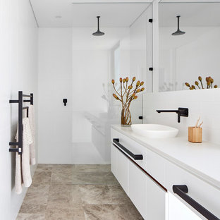 Photo of a contemporary bathroom in Perth with white cabinets, a curbless shower, white walls, marble floors, flat-panel cabinets, a vessel sink, grey floor and white benchtops.