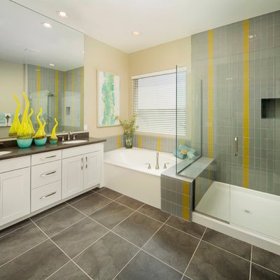 Example of a transitional gray tile and glass tile corner shower design in Phoenix with an undermount sink, shaker cabinets and white cabinets