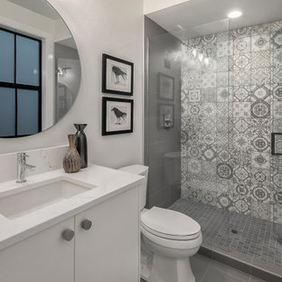 Bathroom - large cottage 3/4 gray floor bathroom idea in Seattle with flat-panel cabinets, white cabinets, white walls, an undermount sink, a hinged shower door and white countertops