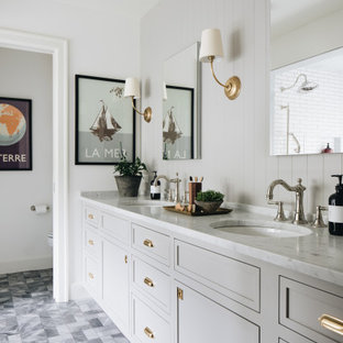 Bathroom - transitional white tile and ceramic tile marble floor, gray floor, double-sink and wall paneling bathroom idea in Grand Rapids with recessed-panel cabinets, gray cabinets, white walls, an undermount sink, marble countertops, white countertops and a built-in vanity