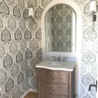 Example of a small classic 3/4 white tile and porcelain tile light wood floor and brown floor bathroom design in Other with furniture-like cabinets, distressed cabinets, gray walls and marble countertops
