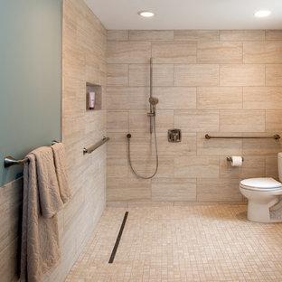 Inspiration for a huge coastal master beige tile and porcelain tile ceramic tile doorless shower remodel in Seattle with blue walls