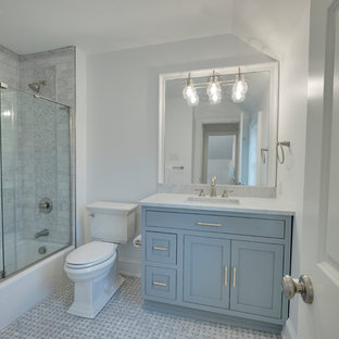 Small transitional kids' multicolored tile and marble tile marble floor and multicolored floor bathroom photo in Philadelphia with flat-panel cabinets, gray cabinets, a one-piece toilet, white walls and marble countertops