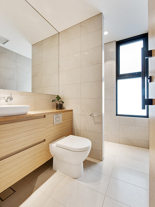 contemporary bathroom in adelaide with flat panel cabinets light wood cabinets beige walls - Contemporary Bathroom Decor Ideas