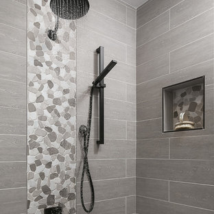 Inspiration for a small traditional shower room in Sacramento with a one-piece toilet, grey tiles, white walls, pebble tile flooring, beaded cabinets, white cabinets, an alcove shower, porcelain tiles, a submerged sink, engineered stone worktops, grey floors and an open shower.