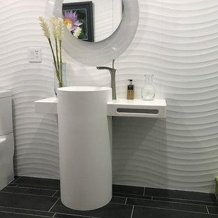 Imagen de cuarto de baño minimalista con lavabo con pedestal