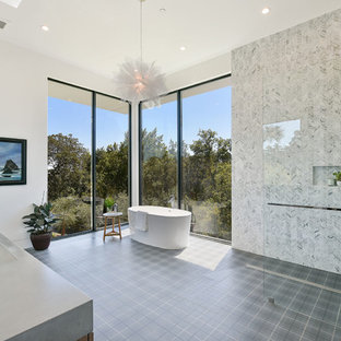 Inspiration for a large contemporary master white tile and mosaic tile gray floor bathroom remodel in Los Angeles with white walls, a trough sink, gray countertops and solid surface countertops