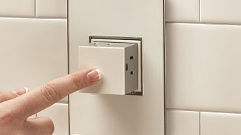adorne® Pop-Out Outlet with 1-Gang Frame in White