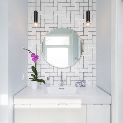 Bathroom - small contemporary master white tile and subway tile marble floor bathroom idea in Toronto with flat-panel cabinets, white cabinets, white walls, an integrated sink and solid surface countertops
