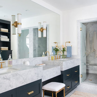 Inspiration for a large transitional master marble floor and gray floor alcove shower remodel in Los Angeles with shaker cabinets, black cabinets, white walls, an undermount sink, marble countertops, a hinged shower door and white countertops