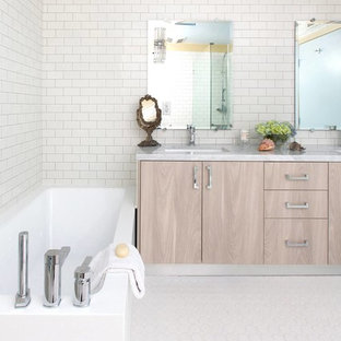 Inspiration for a transitional white tile and ceramic tile bathroom remodel in Los Angeles with an undermount sink, flat-panel cabinets, light wood cabinets, marble countertops and a one-piece toilet