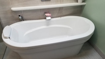Air tub with a moen u and Riobel fixtures