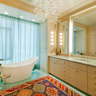 Example of a trendy freestanding bathtub design in Omaha with granite countertops