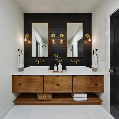 Bathroom - contemporary black tile white floor bathroom idea in San Francisco with flat-panel cabinets, medium tone wood cabinets, white walls, a vessel sink and white countertops