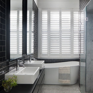 Mid Sized Contemporary Master Bathroom In Melbourne With Black Cabinets, A  Freestanding Tub,