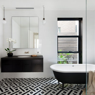 Photo of a contemporary master bathroom in Melbourne with flat-panel cabinets, black cabinets, a claw-foot tub, white walls, an undermount sink and multi-coloured floor.