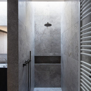 Modern master bathroom in Melbourne with an alcove shower, gray tile, an open shower and grey floor.