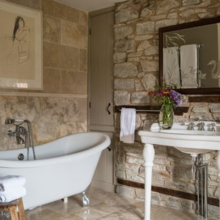 Inspiration for a small shower room bathroom in Other with a claw-foot bath, stone slabs, beige walls, beige tiles, a console sink and beige floors.