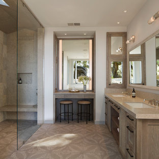Farmhouse beige tile beige floor walk-in shower photo in San Francisco with recessed-panel cabinets, light wood cabinets, white walls, an undermount sink and beige countertops