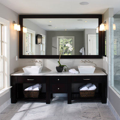 Bathroom - transitional marble tile bathroom idea in DC Metro with marble countertops and a vessel sink