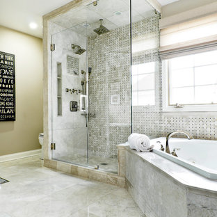 This is an example of a large contemporary ensuite bathroom in Chicago with an alcove shower, beige tiles, a built-in bath, stone tiles, grey walls and marble flooring.