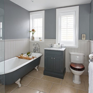 Design ideas for a medium sized classic bathroom in Edinburgh with shaker cabinets, grey cabinets, a freestanding bath, a two-piece toilet, beige tiles, grey walls, a submerged sink, marble worktops and limestone flooring.