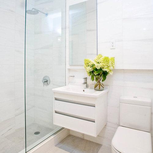 Small modern 3/4 white tile and porcelain tile white floor bathroom idea in  New