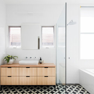 Inspiration for a mid-sized contemporary master bathroom in Melbourne with light wood cabinets, an alcove tub, an open shower, white tile, porcelain tile, mosaic tile floors, wood benchtops, flat-panel cabinets, white walls, a vessel sink and multi-coloured floor.