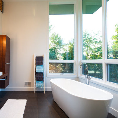 Trendy freestanding bathtub photo in Grand Rapids with a vessel sink