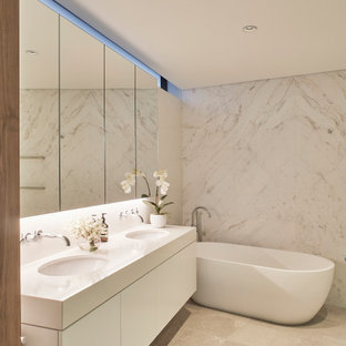 Design ideas for a mid-sized contemporary master bathroom in Sydney with flat-panel cabinets, white cabinets, a freestanding tub, beige tile, gray tile, an undermount sink, beige floor, beige benchtops, a double vanity and a floating vanity.