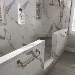Inspiration for a mid-sized master bathroom in Atlanta with shaker cabinets, white cabinets, a freestanding tub, an open shower, a one-piece toilet, gray tile, porcelain tile, grey walls, porcelain floors, an undermount sink, granite benchtops, brown floor, an open shower, white benchtops, a shower seat, a double vanity, a built-in vanity, coffered and wallpaper.