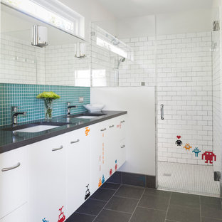 1950s kids' blue tile and mosaic tile gray floor walk-in shower photo in Austin with flat-panel cabinets, white cabinets, white walls and gray countertops
