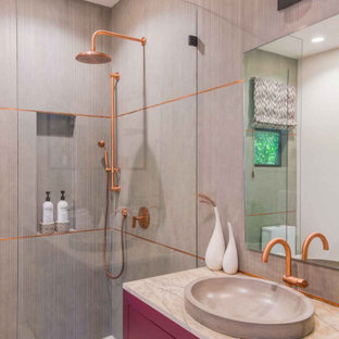 Bathroom - mid-sized modern beige tile and porcelain tile porcelain tile and white floor bathroom idea in Los Angeles with flat-panel cabinets, a one-piece toilet, white walls, a drop-in sink, marble countertops and beige countertops