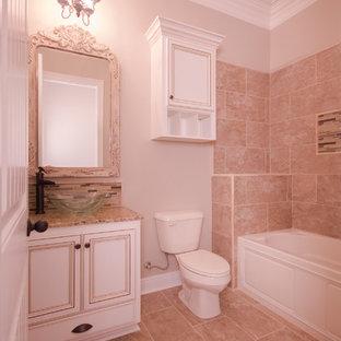 Ispirazione per una stanza da bagno tradizionale con ante lisce, vasca/doccia, piastrelle beige, piastrelle a mosaico, pareti beige, pavimento in gres porcellanato, lavabo a bacinella e top in granito