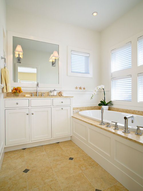 Coastal Beige Tile Drop In Bathtub Photo In New York With Shaker Cabinets  And White
