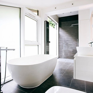 Inspiration For A Mid Sized Modern Master Black Tile And Stone Floor Bathroom