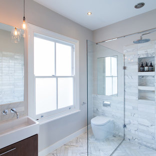 Design ideas for a medium sized contemporary bathroom in London with white tiles, marble tiles, white walls, marble flooring, a console sink, white floors, an open shower, flat-panel cabinets, brown cabinets and a one-piece toilet.