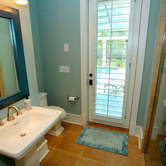 tropical bathroom by Lendry Homes