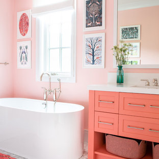 Freestanding bathtub - mid-sized cottage kids' freestanding bathtub idea in New York with shaker cabinets, pink walls and white countertops