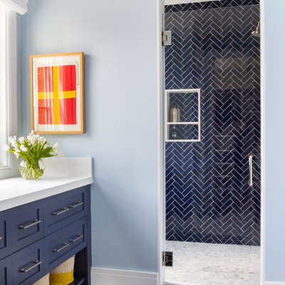 Example of a mid-sized farmhouse kids' blue tile alcove shower design in New York with shaker cabinets, blue cabinets, blue walls, a hinged shower door and white countertops