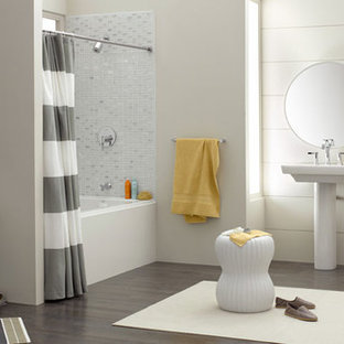 Medium sized classic ensuite bathroom in Other with an alcove bath, a shower/bath combination, a one-piece toilet, grey tiles, mosaic tiles, white walls, dark hardwood flooring, a pedestal sink, brown floors and a shower curtain.
