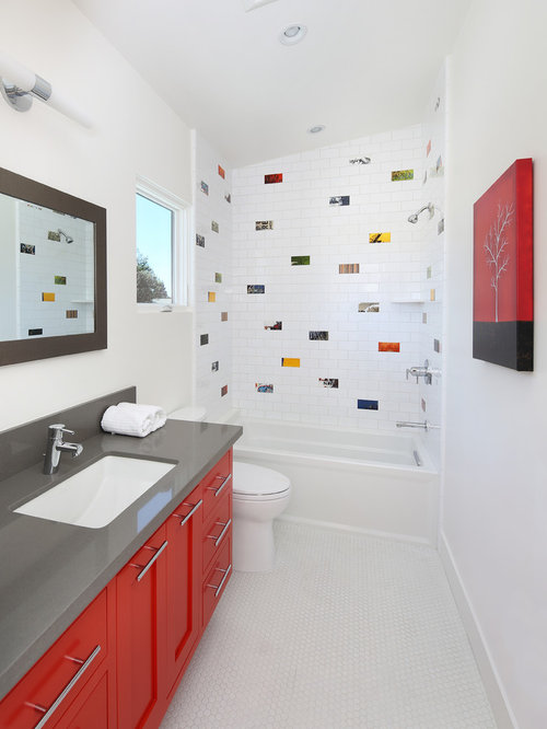tile bathroom idea in san francisco with an undermount sink red cabinets and